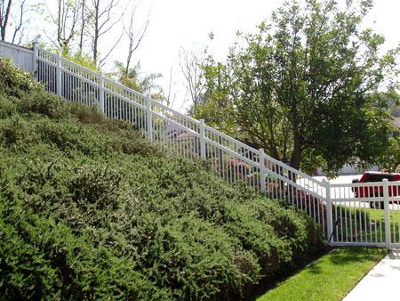 Picket Fence Slope Vinyl Pro Fence