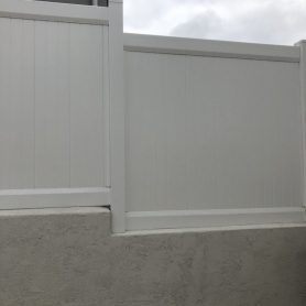 5 foot tall full privacy vinyl fence installed on top of a existing stucco wall