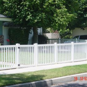 Closed top vinyl picket fence.