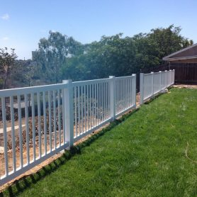 48 inch tall white vinyl picket perimeter fence.