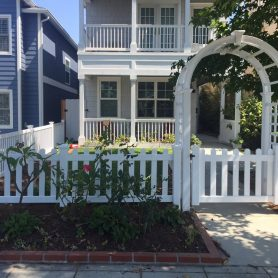 Dog ear picket fence with Arbor in Coronado