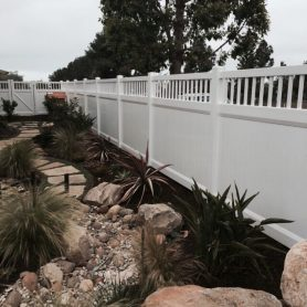A white vinyl privacy with picket accent fence in Encinitas